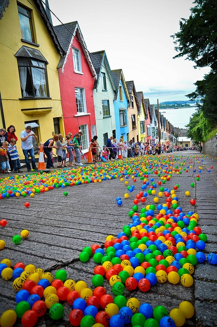 The Barrack Hill Ball Roll is a unique lottery when thousands of coloured numbered balls cascade and bounce down West View in Cobh, Ireland (by KerryJordanTog).