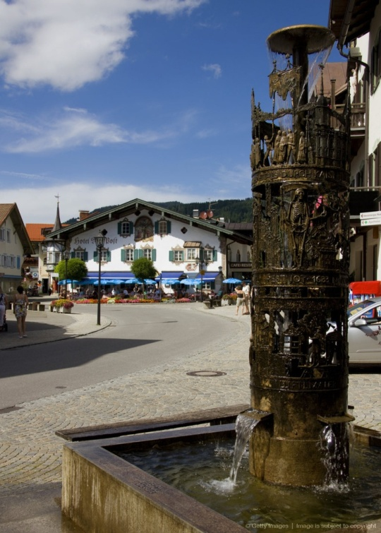 07.Fountain and painted facade of Restaurant Alte Post in Oberammergau, Bavaria, Germany