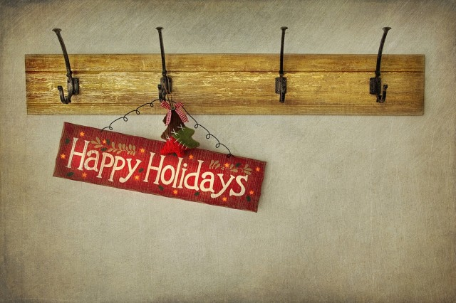 Wooden holiday sign on antique plaster wall